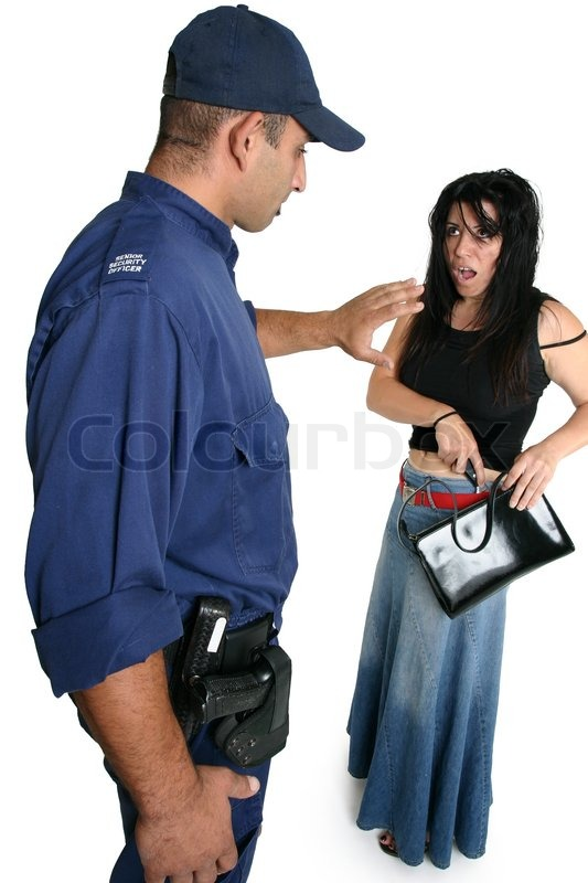 security officer approaches an armed criminal with caution