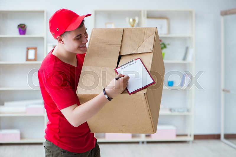 Post man delivering a parcel package, stock photo