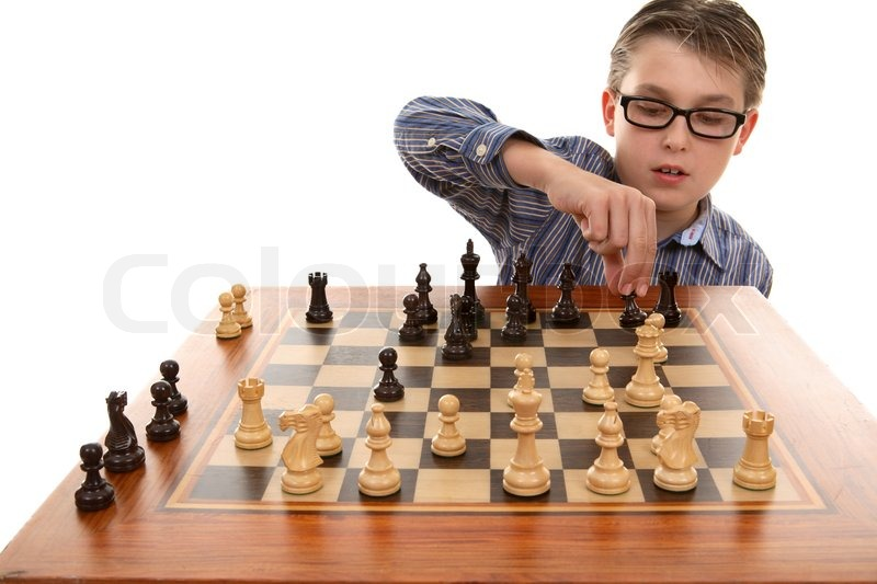 A boy moving a chess piece on a portable chess game table Where can i buy a chess game