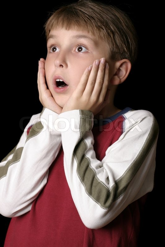 a young boy child with a shocked or startled expression
