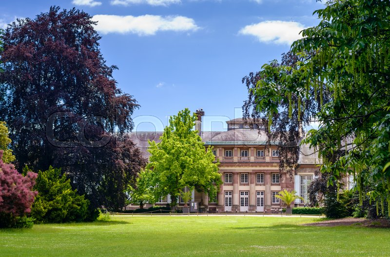 Scenic view of historical mansion and landscaped formal gardens in summer, stock photo