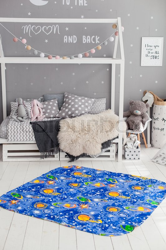 Modern interior of the child\'s bedroom with carpet in front. Loft grey style, stock photo