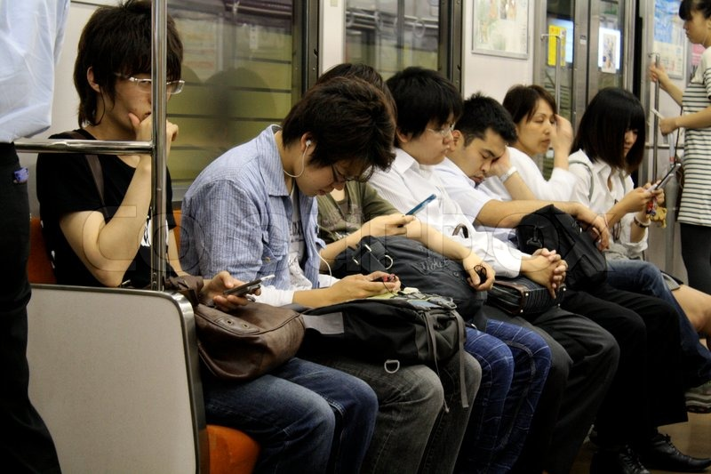 Japanese people in a train on sina way home from work, stock photo