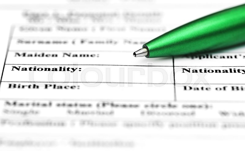Visa application form filling with green ballpoint, stock photo