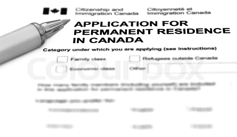 Visa application form filling with silver ballpoint, stock photo