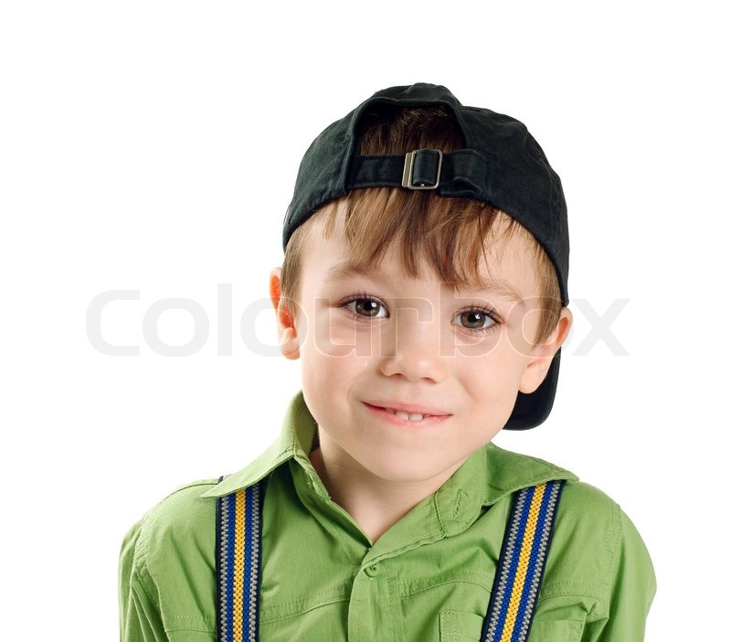 portrait of small boy in baseball cap isolated on pure white
