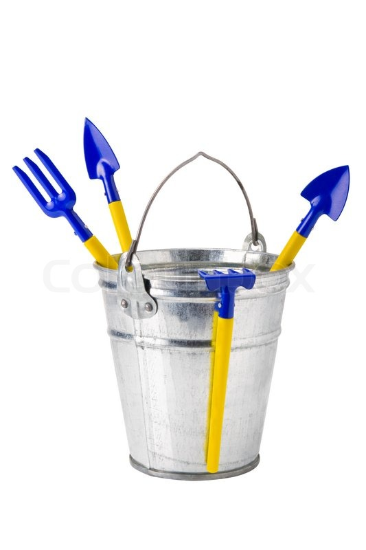 Garden bucket with gardening tools isolated on white Stock Photo