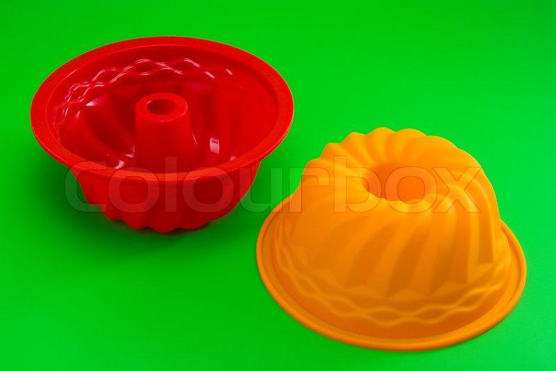 rote und orange silikon kuchen schimmel auf gr n. Black Bedroom Furniture Sets. Home Design Ideas