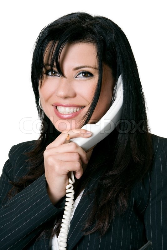 Stock image of 'Courteous business woman, working woman answering a telephone call'