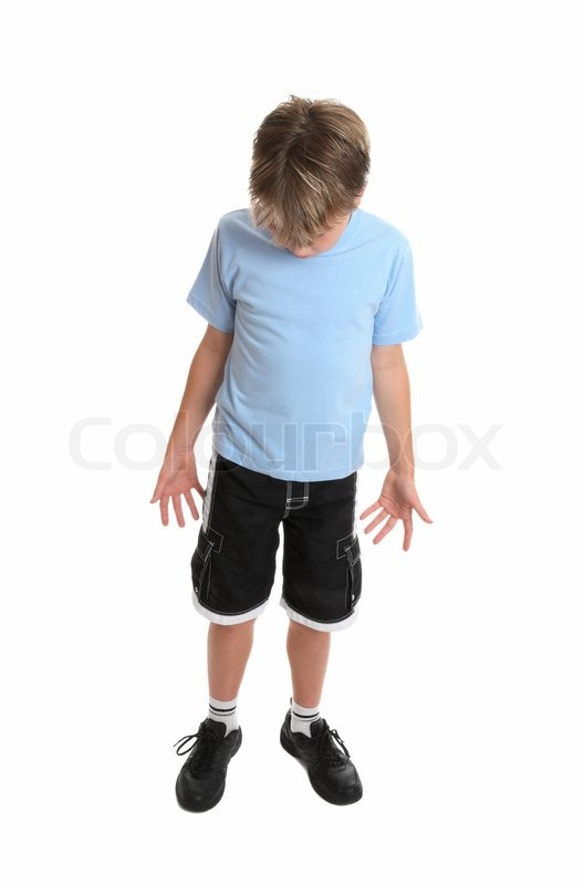 boy standing in plain blue t shirt and black shorts looking down stock photo colourbox. Black Bedroom Furniture Sets. Home Design Ideas