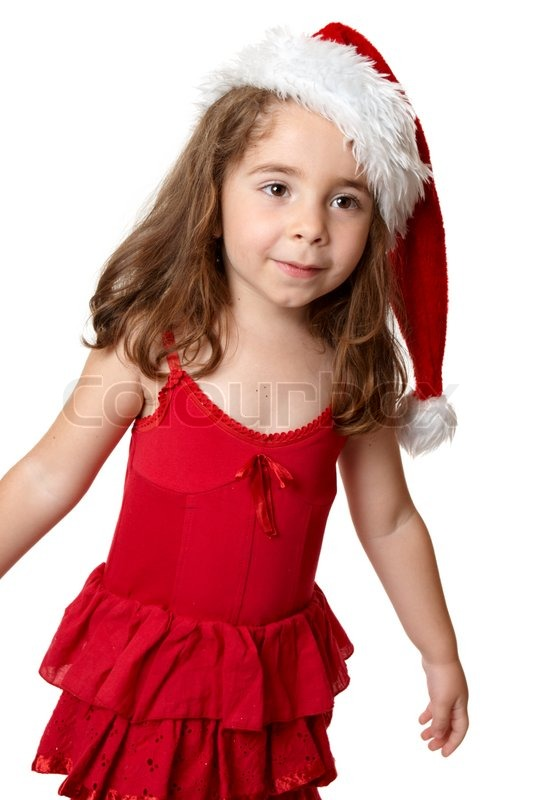 Prety girl wearing a red dress and red santa hat at christmas stock