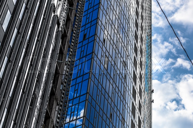 Builders of the tallest building in Kiev on high-altitude works, stock photo