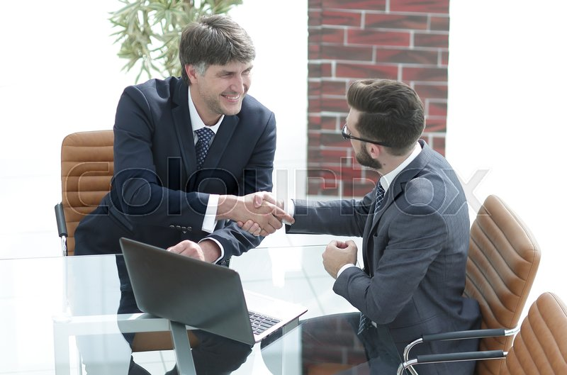 Hands shake between two successful business people concept of partnerships, stock photo