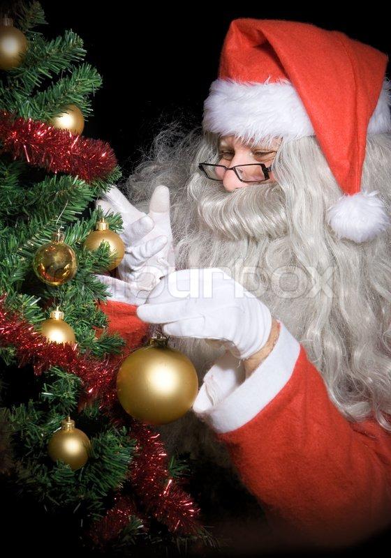 santa claus decorate christmas tree stock photo colourbox - Santa Decorated Christmas Tree