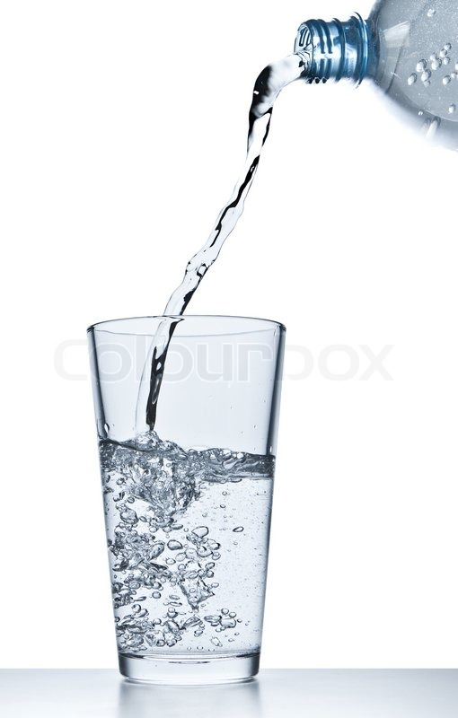 water pouring into glass on white stock photo colourbox