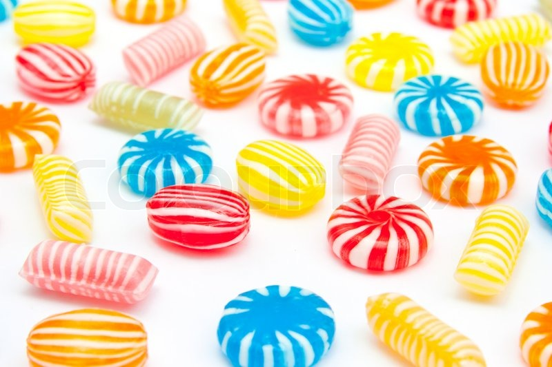 Stock image of 'Many different color candies on white'