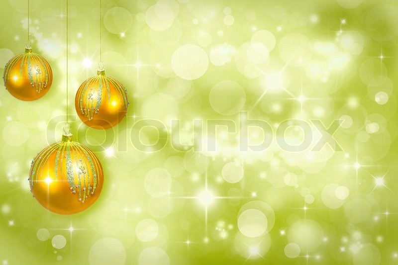 Yellow Christmas Ornaments On A Green Background Defocused