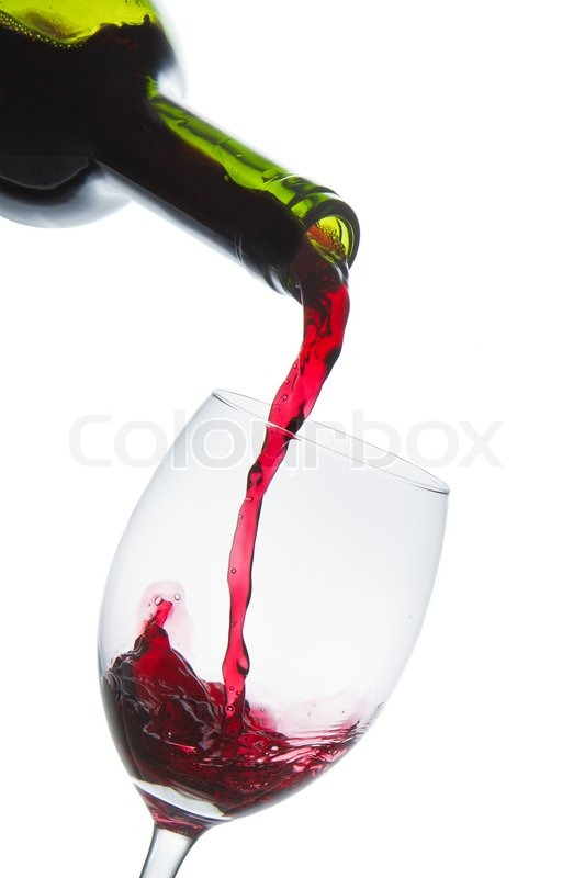 red wine pouring into wine glass isolated stock photo