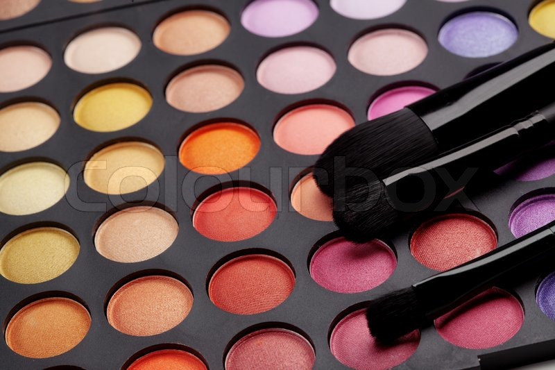 Make Up Colorful Eyeshadow Palette With Makeup Brushes On It