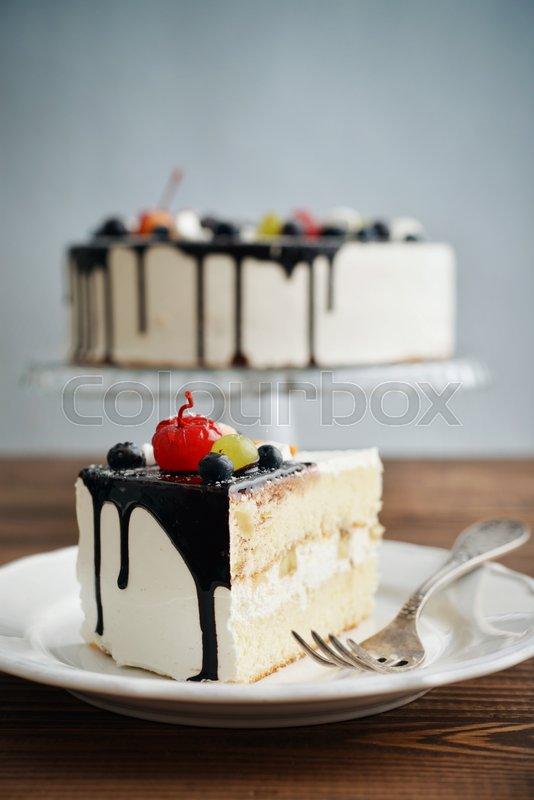 Fruit Birthday Cake With Cake Slice Over Blue Background Stock