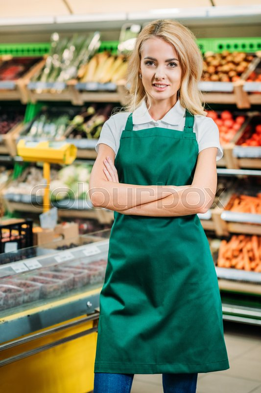 Portrait Of Shop Assistant In Apron With Arms Crossed