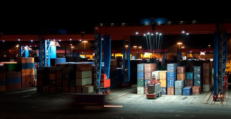Busy Commercial Container Port At Night With Cranes And