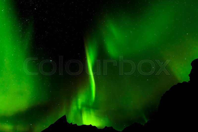 A Beautiful Green Aurora Borealis Or Northern Lights, Norway, Selective  Focus   Stock Photo   Colourbox