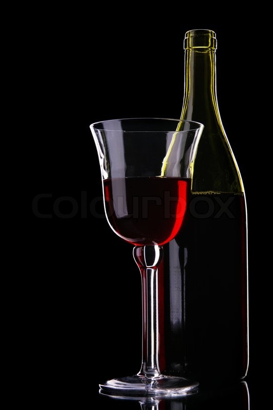 Still life with bottle and glass of red wine over black for Red glass wine bottles suppliers