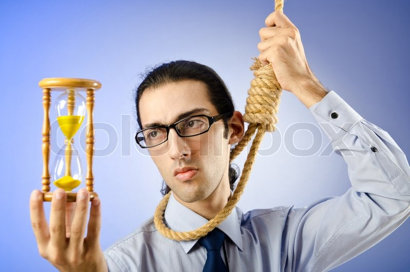 Guy looking at noose