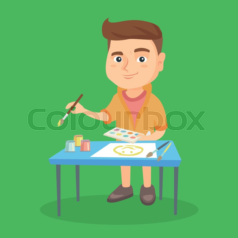 caucasian boy standing near the table and painting with a paint