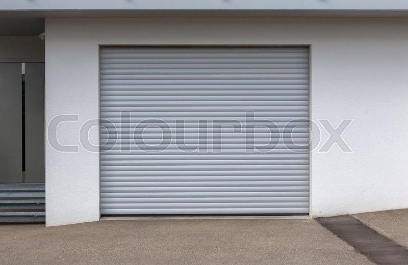 New door of a garage, empty street, stock photo