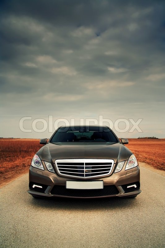 Wide front view of modern sporty saloon, stock photo