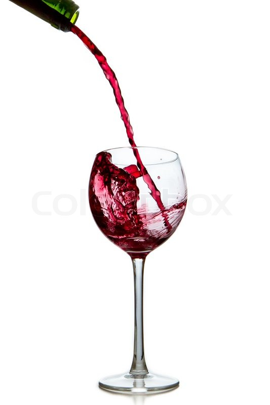 Pouring red wine from bottle into glass | Stock Photo ...