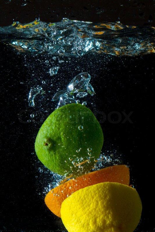 Fruit splashing in the water, stock photo