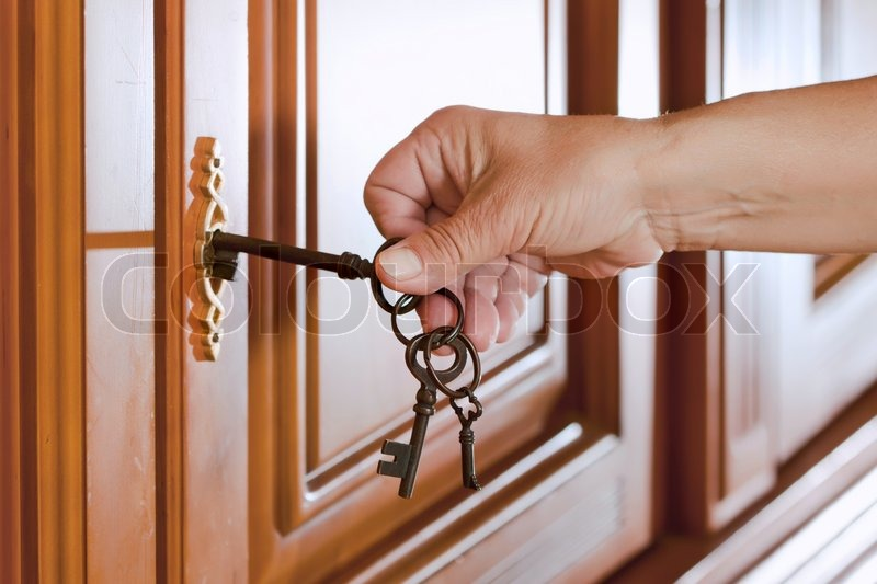 Locking up or unlocking the door with a key in hand | Stock Photo | Colourbox & Locking up or unlocking the door with a key in hand | Stock Photo ...