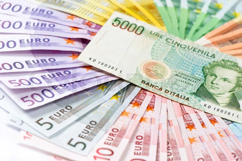 Stock image of 'Old italian lire its no existing money over euro currency banknotes'
