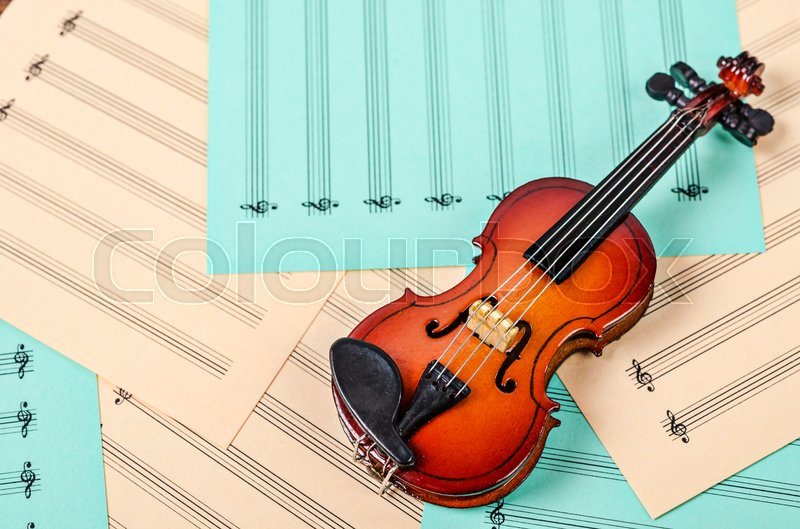 Violin on blank sheets note. Musice concept, stock photo