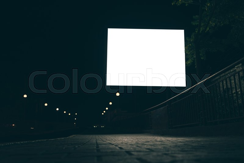 Blank advertising screen in the street at night, low angle shooting, stock photo