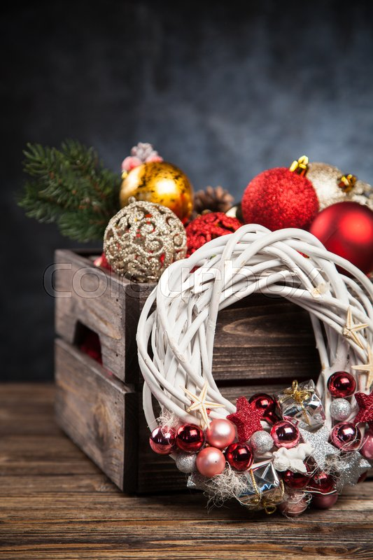 Christmas ornaments in a wooden crate, stock photo