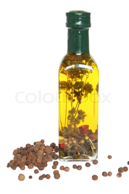 Small Bottle Of Olive Oil With Spices Stock Photo