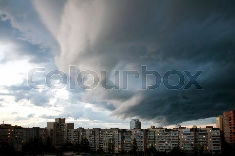 Heavy rain clouds over the city. Stormy sky over the buildings. Typical modern residential district. Kiev, Ukraine, stock photo