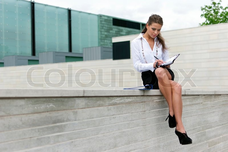 New Woman In Skirt Sitting On Floor  Stock Photo  Varlyte 2461547
