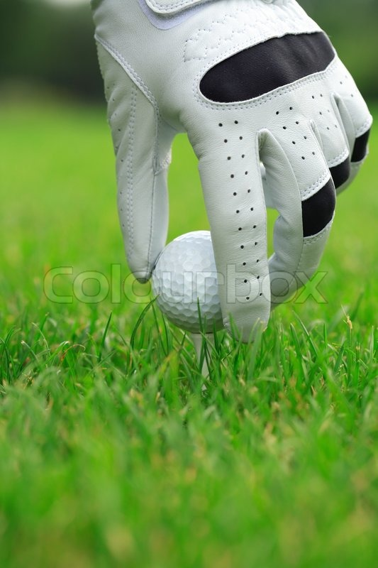 Detail of golf ball and gloves, stock photo