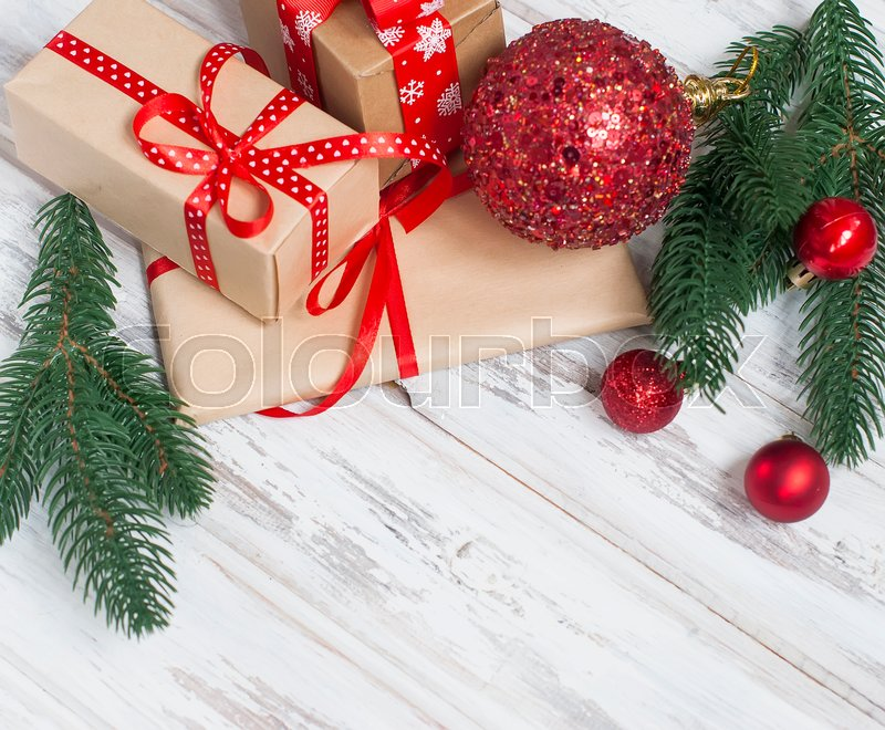 Merry Christmas gift boxes, fir branches, cones, Christmas decorations on the old wood table. Gift Magic christmas card, stock photo