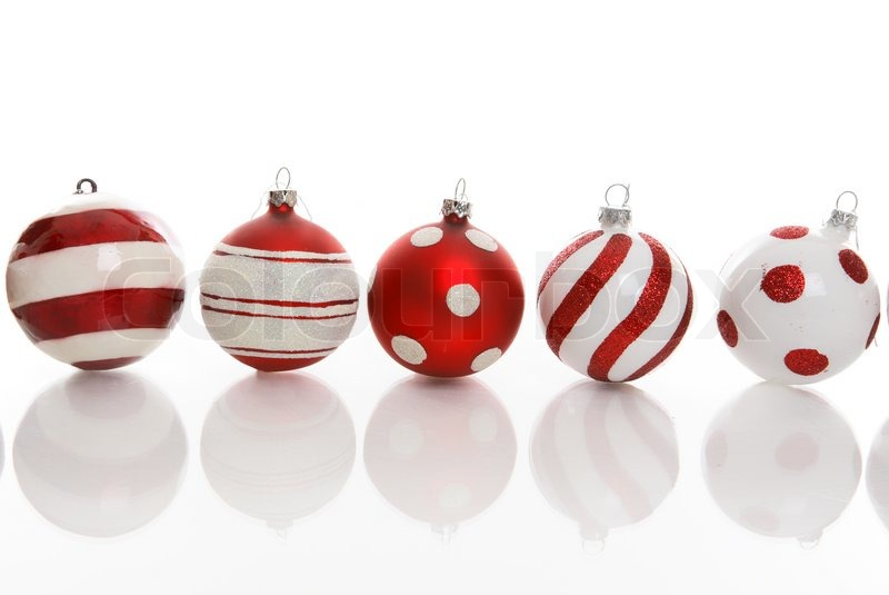 Red and white christmas baubles with various designs on a for White christmas baubles
