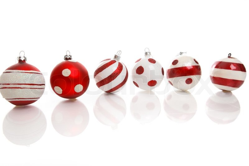 Red and white Christmas baubles on a white background with space ...