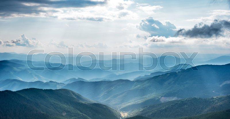 Mountain landscape with sun beams in ukrainian Carpathiaan, stock photo