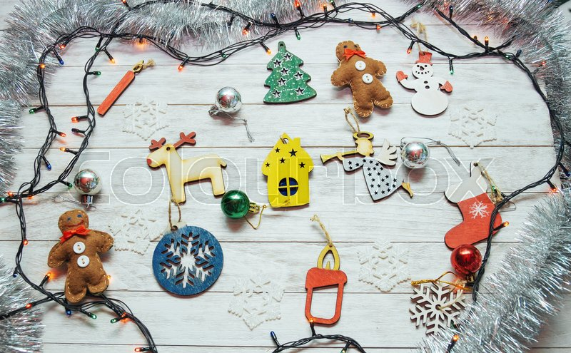 Christmas ornaments and garland lights on wooden white background. Happy New Year. On the eve of the holiday, stock photo