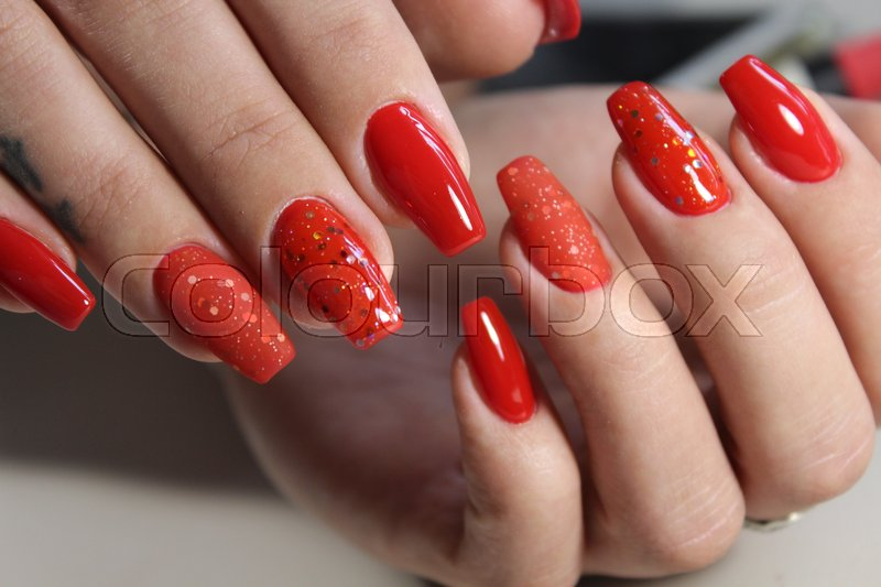Long beautiful red nails, effective manicure design | Stock Photo ...