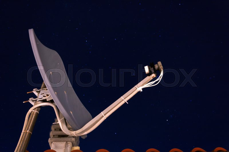 Satellite dish receiver with a night starred sky, stock photo